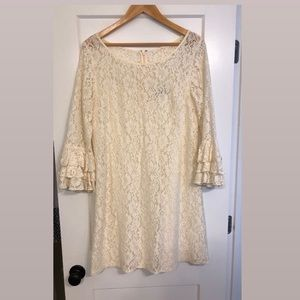 White lace shift dress with ruffle sleeves
